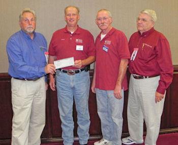 Ohio Gun Collectors Assoc. presents check to BFA