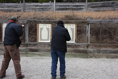 Students shooting the one handed, off hand section in qualification