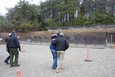 Instructors work with students on shooting while moving